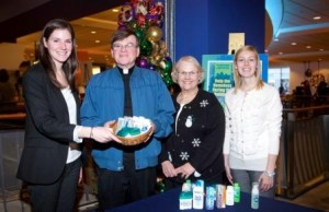 Pictured left to right are: Mary Fallon, Media Director at Garvey Communication Associates Inc.; Father Jim Brennan, Co-Director of St. Francis Chapel; Ellen Lambert, volunteer; and Amanda Gauthier, Social Media Assistant at Garvey Communication Associates Inc.