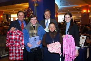 L-R: Anthony Cignoli, president of A.L. Cignoli; Fr. Brennan, co-director at St. Francis Chapel; Don Anderson, owner of the Cruise Store; Aida Claudio, volunteer at St. Francis Chapel; and Mary Fallon, media director at Garvey Communication Associates Inc.